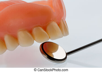 teeth and mouth mirror, symbolic photo for dentures,...
