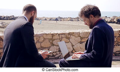 Business men working on the beach