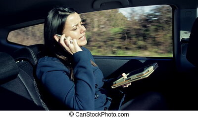 Business woman angry in car on the phone talking to client