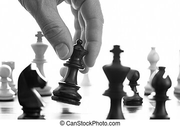 Chess game black queen advances bw close up of hand