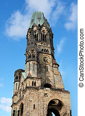 Kaiser Wilhelm Memorial Church with blue skies in the...