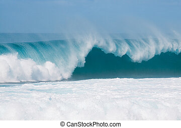 Breaking Waves - Large waves break off the north shore of...