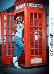 talking tourist - Pretty young woman talking on the phone in...