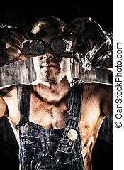 goggle - Close-up portrait of a strong muscular man coal...