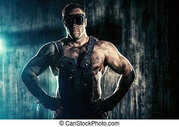 muscular worker - Portrait of a strong muscular man coal...