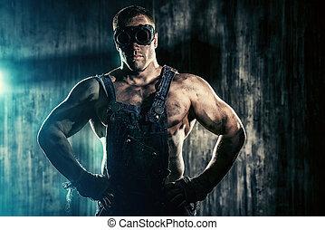 muscular worker - Portrait of a strong muscular man coal...