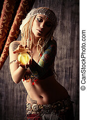 fortune teller - Magnificent fortune teller holding crystal...