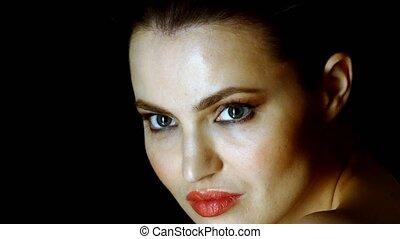 woman posing in dark room