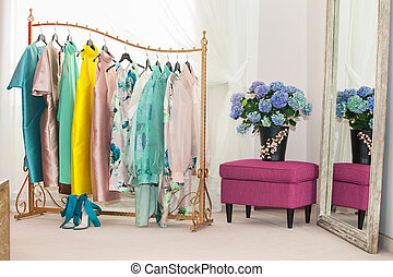 Interior of the luxury shop of fashionable clothes