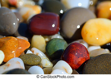 Multi-colored pebbles - Wet multi-colored pebbles on the...