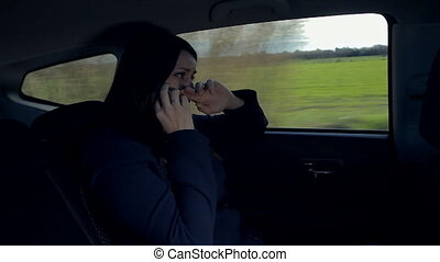 Woman crying in car sad - Woman on the phone in car almost...