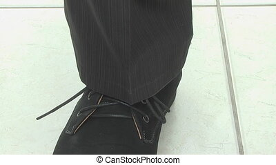 man unties shoelaces and takes off