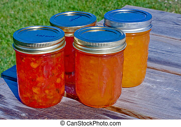 Summer Preserves - Assortment of summer preserves on a table...