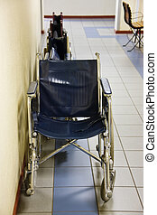 Hospital wheelchairs - Wheelchairs parked on the side of a...