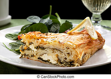 Spinach Pie - Spinach pie and salad, with a glass of wine.