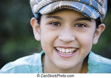 Portrait Of Smiling Tween Girl - Tween Girl Wearing Cap...