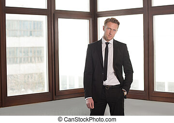Portrait of businessman in office - He is handsome and...