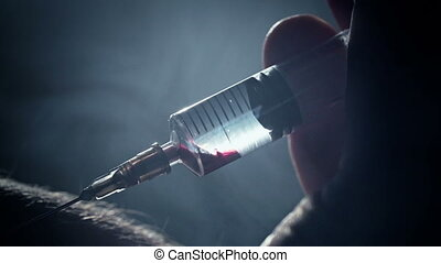 Junkie addict injects heroin or meth by syringe into a vein....