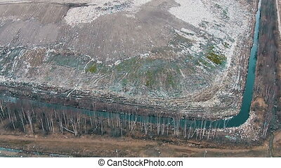 Aerial Shot Landfill with Working Trucks and Tractor, top...