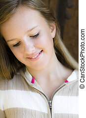 Tween Girl - Portrait of Smiling Tween Girl standing in...