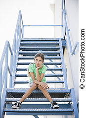 Portrait of Tween Girl Sitting On Stairway