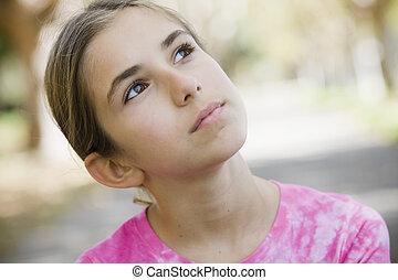 Portrait of Tween Girl Looking up to the Sky