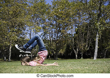 Portrait of Tween Girl Doing Gymnastics on Lawn