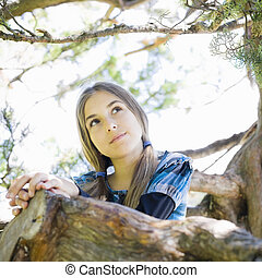 Portrait of Tween Girl in Tree - Portrait of Smiling Tween...
