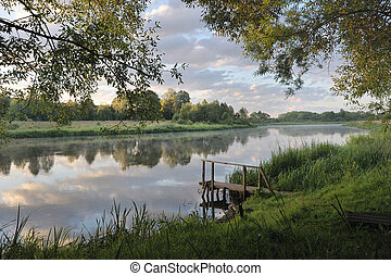 Dawn on the river Vilija, Belarus The sky with clouds, the...