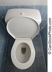 toilet - vertical photo of a white clean toilet, tiles on...