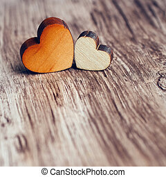 Love - two hearts on a wooden surface