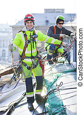 Industrial climbers working on roof of building - Industrial...