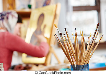 icon painting concept - Iconography. brushes heap with woman...