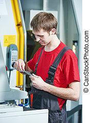 industrial worker measuring tool at workshop