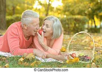 Amusing old couple - Portrait of an amusing old couple on...