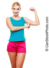 Young woman teen girl showing her muscles - strength and...