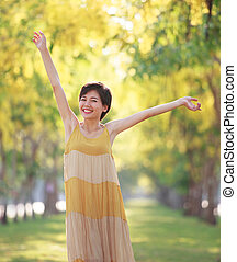 portrait of beautiful young asian woman feeling free with...