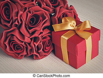 red flowers and gift box with yellow ribbon - red gift box...