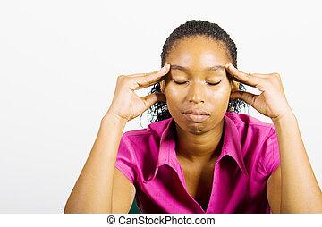 african headache woman - an african woman holding her head...