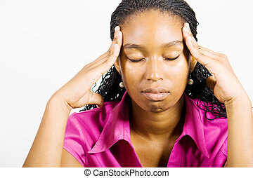 headache woman - an african american woman with her hands on...