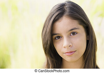 Teen Girl - Hispanic Teenage Girl Looking Directly To Camera