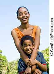 mother and son - a mother and son happily posing together in...