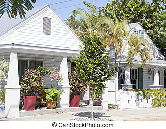 Key West Houses - White color wooden houses full of greenery...