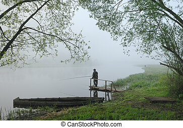 Morning on the River - Fishermen on the river early in the...