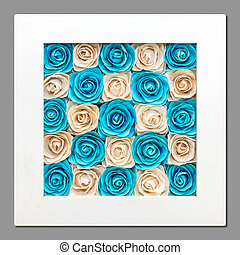 Roses, artificial roses in a picture frame that is decorated...