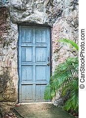 Old door - A weathered blue door until pale old.