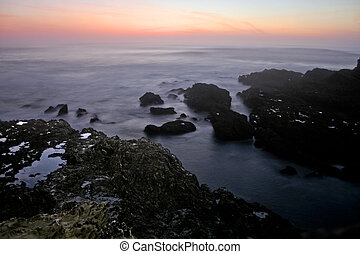 Rocks and sunset - Rocks of Porto Covo Beach in Algarve...