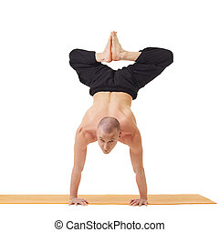 Yogi looking at camera while doing handstand, isolated on...