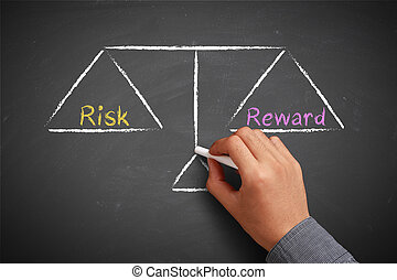 Risk and reward balance - Hand with chalk is drawing Risk...