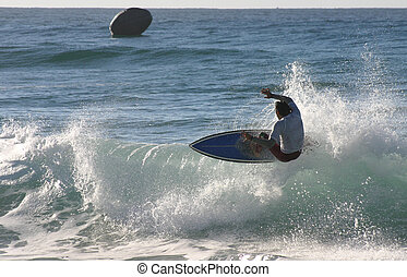 A surfer floats of the lip on a right hand wave Newcastle...
